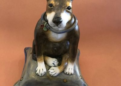 Dog on a Cushion by Debra Powell